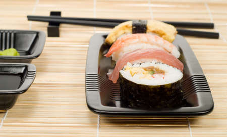 assortment of sushi on a bamboo mat photo