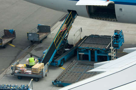 airplane cargo: loading cargo on a big plane