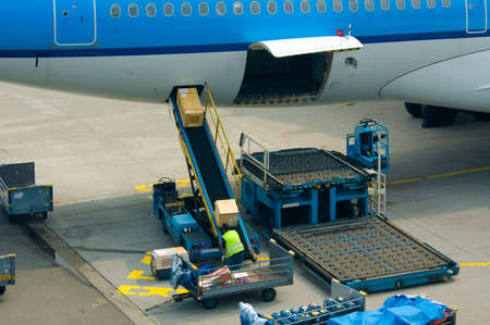 loading cargo on a big plane photo