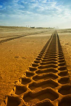 tire tracks: big tire tracks on the beach Stock Photo