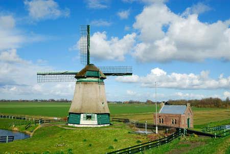 ijsselmeer: beautiful windmill landscape near the IJsselmeer in the netherlands