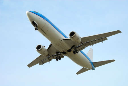 underneath: airplane on takeoff with blue sky background Stock Photo