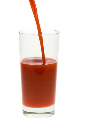 glass of fresh tomato juice isolated on a white background photo
