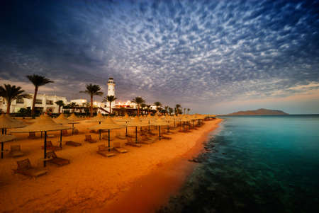 sunset and turquoise ocean in sharm el sheikh, egyptrr photo