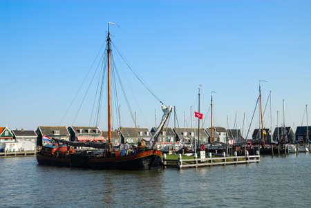 old dutch houses and boats in Marken a small village near Amsterdam photo