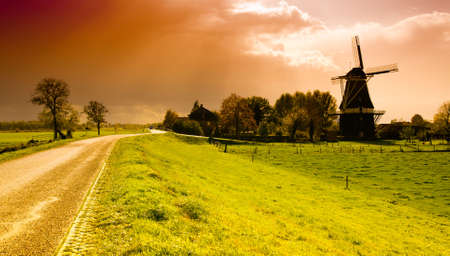 beautiful sunset windmill landscape in the netherlands photo