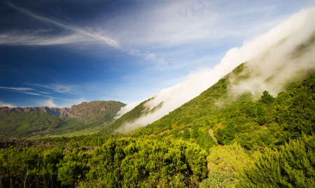palma: clouds rolling off the mountain in La Palma (canary islands spain)