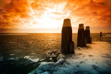 snowlandscape: Cold winter sunset landscape (ijsselmeer Netherlands)