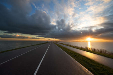 marken: road towards the sunset (Marken the Netherlands) Stock Photo