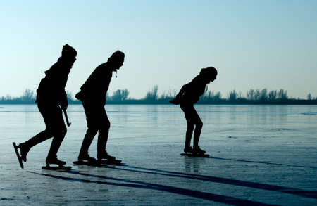 frozen lake: ice skating in the netherlands