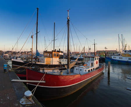 fishing boats in the harbor of Urk, The Netherlands photo