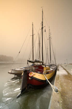 friesland: Dutch sailing boat on a cold day in winter (Friesland, The Netherlands)