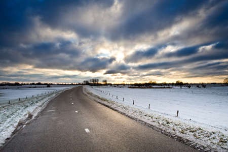 ijssel: winter country road in the netherlands