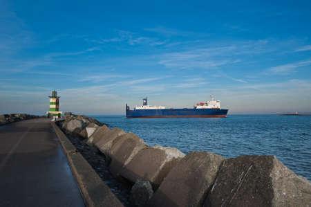 ijmuiden: Big ship leaving the harbor of IJmuiden, The Netherlands Stock Photo
