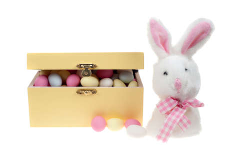 box of sugar covered almonds sweets with bunny , isolated on a white background photo