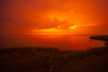 ijsselmeer: beautiful sunset at a lake IJsselmeer in the netherlands