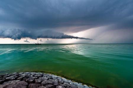 ijsselmeer: A storm cloud approaching on the IJsselmeer in The Netherlands  Stock Photo