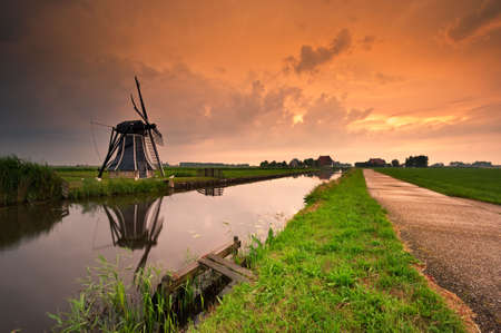 beautiful sunset windmill landscape in Friesland the netherlands Foto de archivo