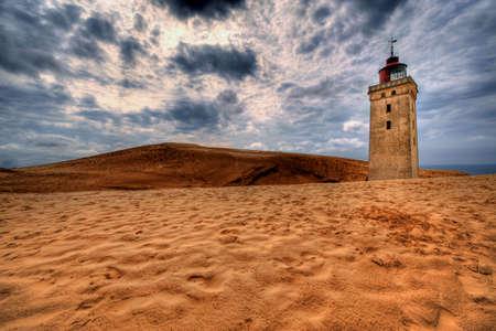jutland: Lighthouse in the sand dunes of Rubjerg Knude in Denmark
