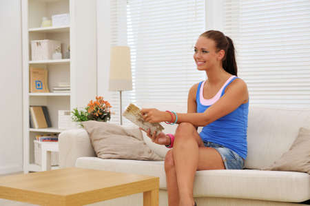young attractive woman in the living room reading a book Stock Photo - 5372592