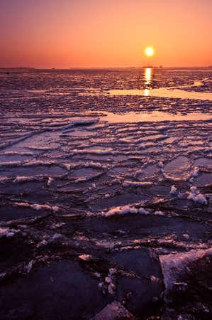 Frozen lake and sunset, Durgerdam The Netherlands photo