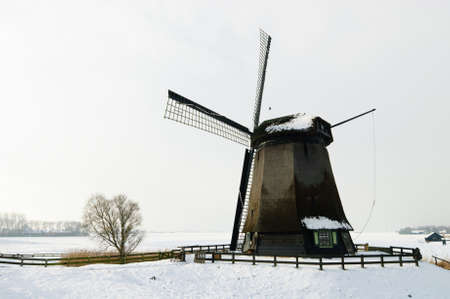 Beautiful winter windmill landscape in Schermerhoorn the Netherlands  photo