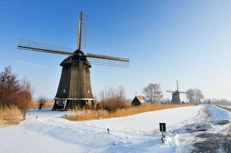 Beautiful winter windmill landscape in Ursum the Netherlands  photo