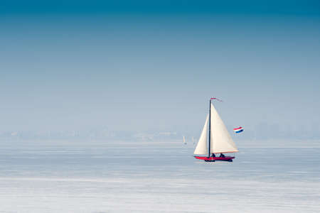 marken: Ice sailing on the frozen lake (gouwzee Between Edam and Marken Netherlands)