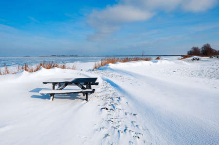 marken: snow dunes at a lake in Winter (Marken The Netherlands)