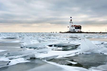 cloud drift: shelf ice and lighthouse  in Marken a small village near Amsterdam The Netherlands