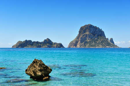 The islands and turquoise waters Es Vedra Cala dHort Ibiza Spain