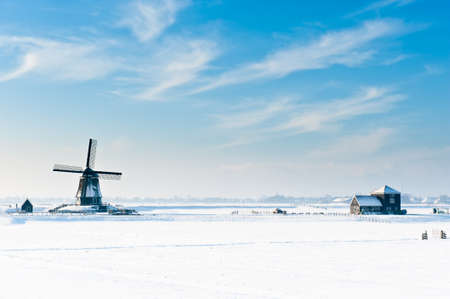 Beautiful winter windmill landscape in Oosthuizenthe Netherlands  Фото со стока