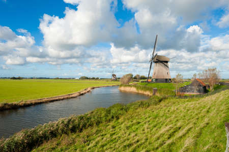 beautiful windmill landscape in the Netherlands, Schermerhorn, Schermer, Noord-Holland  Stock Photo - 8811923