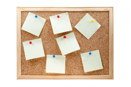 different sticky notes on a cork board isolated on a white background photo