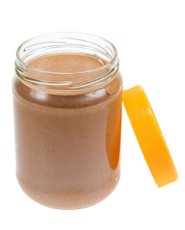 Jar of peanut butter isolated on a white background photo