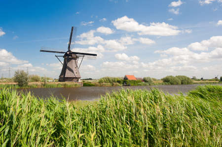 Windmill landscape at Kinderdijk near Rotterdam The Netherlands Stock Photo - 9749479