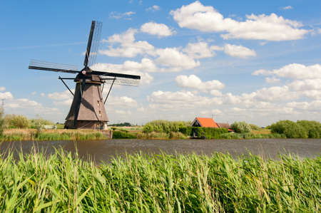 wind mill: Windmill landscape at Kinderdijk near Rotterdam The Netherlands Stock Photo