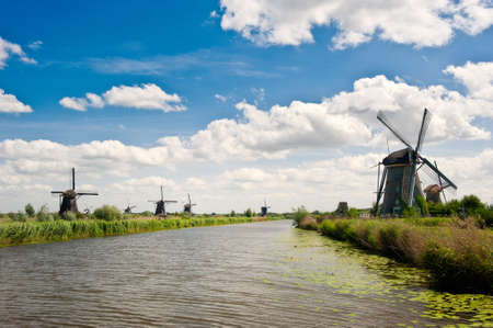 Windmill landscape at Kinderdijk near Rotterdam The Netherlands Фото со стока