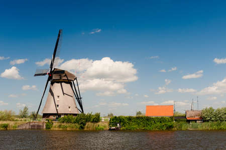 Windmill landscape at Kinderdijk near Rotterdam The Netherlands Stock Photo - 9749475