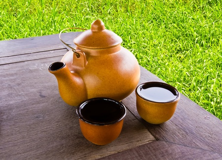 earthenware tea pot with two cups Stock Photo