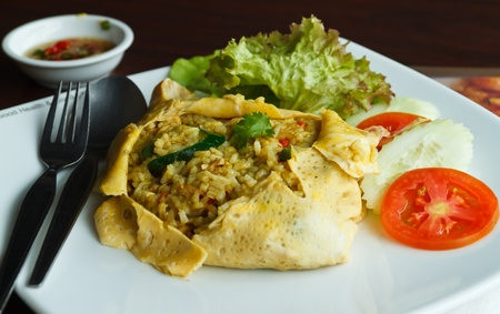 Omelet parcel fried rice green curry Stock Photo