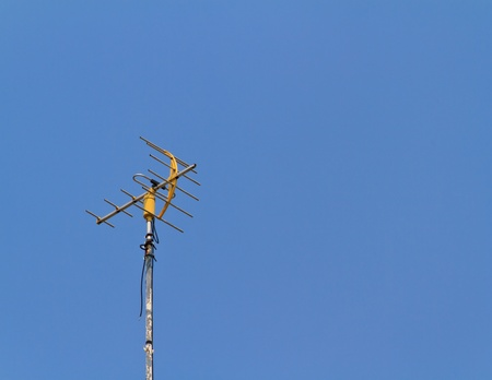 structure of old antenna with blue sky background
