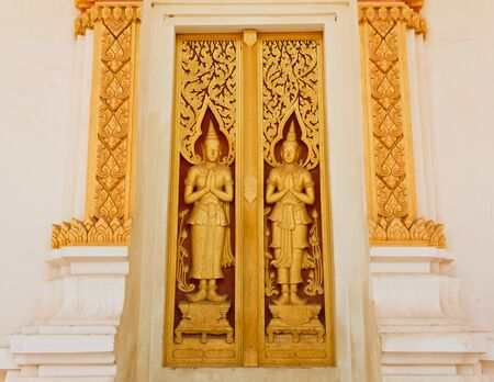 Buddhist temple door fine arts and Thai painting Stock Photo