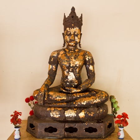Antiquated iron Buddha image in Roi-Et, Thailand Stock Photo