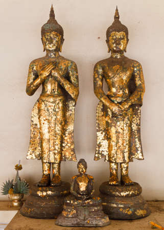 Different Style of Couple Buddha image and Smaller sit style in SongKran festival Stock Photo