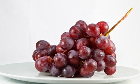 Instant fresh red grape on white dish and white background