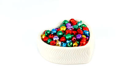 colorful small bell in white heart earthenware