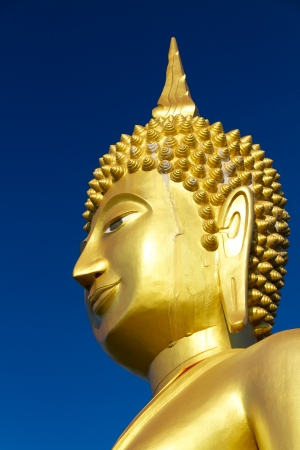 Golden big statue Buddha blister colour by sunlight effect