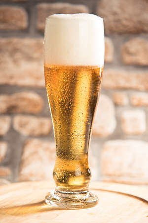 weiss: pint of beer on wooden plan with rustic background Stock Photo