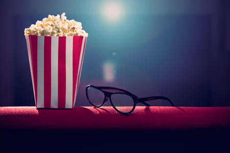 pop corn and 3d glasses on armchair cinemas